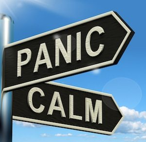 Panic Or Calm Signpost Showing Chaos Relaxation And Rest
