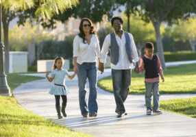 family walking along path at a park